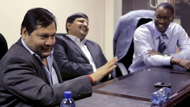 Ajay and Atul Gupta with Duduzane Zuma in March 2011.