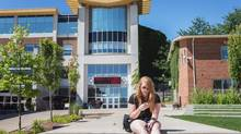 """Ceara Bruce, an English major at Wilfrid Laurier University, relaxes on campus on August 8, 2013. The town of Milton, which had a 56.5-per-cent surge in population from 2006 to 2011, has teamed up with Wilfrid Laurier University on a campus proposal and """"education village"""" that has been in the works since 2008. (JENNIFER ROBERTS For The Globe and Mail)"""