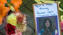 A photo of Kimberly Proctor, an 18-year-old from Langford whose burned body was found Friday at Millstream Creek beneath the Galloping Goose Trail along the Langford-Colwood border, sits at a memorial Tuesday near the location she was discovered. (GEOFF HOWE/Geoff Howe for The Globe and Mail)