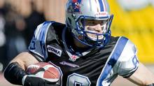 Montreal Alouettes' Ben Cahoon runs upfield after making a catch against the Calgary Stampeders during first half CFL football action in Montreal, Monday, October 11, 2010. THE CANADIAN PRESS/Graham Hughes (Graham Hughes)