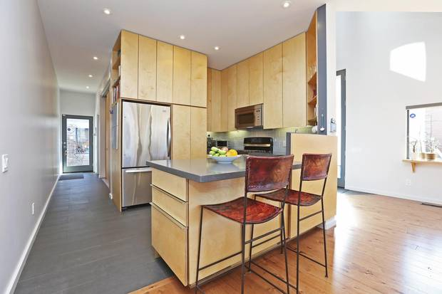The kitchen cabinets are made from warm birch.