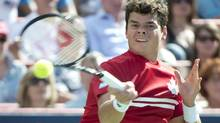 Canada's Milos Raonic returns to Rafael Nadal from Spain during the final at the Rogers Cup tennis tournament in Montreal (Paul Chiasson/THE CANADIAN PRESS)