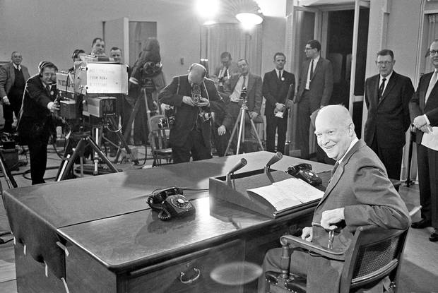 President Eisenhower swings around in his White House office chair in Washington in 1961, just before he started his farewell television-radio address to the nation.