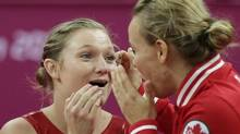 Canada's gold medallist Rosannagh Maclennan, left, and Karen Cockburn celebrate during the women's trampoline final at the 2012 Summer Olympics, Saturday, Aug. 4, 2012, in London. (Gregory Bull/AP)