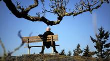 Paul Butterfield is framed with a Garry Oak tree in Viewpoint Park in the Saanich district area of Greater Victoria as he nears completing his quest to visit all 149 official parks in the district. (Chad Hipolito for The Globe and Mail/Chad Hipolito for The Globe and Mail)