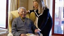 U.S. Secretary of State Hillary Clinton meets with Nelson Mandela, 94, at his home in Qunu, South Africa on Aug. 6, 2012. (POOL/REUTERS)