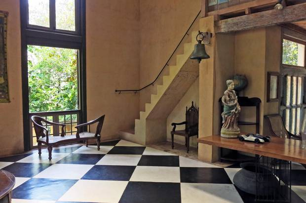 A simple black, white and earth-toned palette were used by local architect Geoffrey Bawa on the interiors of Lunuganga, his tropical modernist retreat in Bentota.
