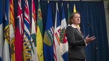 Alberta Premier Alison Redford acknowledges that Ottawa's proposed health transfer is an advantage to the province, but says she will work with the other provinces to 'fully explore' its consequences. (Andy Clark/Reuters)