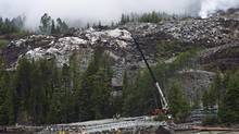 Heavy equipment won the site of the Kitimat Liquified Natural Gas project at Bish Cove, south of Kitimat, BC., on Wednesday, June 27, 2012. (Robin Rowland/THE CANADIAN PRESS)