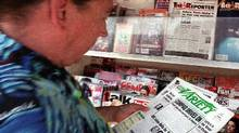 Newsstand browser Les Brown reads a copy of the trade paper Variety at a newsstand in the Hollywood section of Los Angeles, Friday, Aug. 24, 2001. (Reed Saxon/AP Photo)