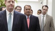 U.S. House Speaker John Boehner, centre, leaves after a GOP conference meeting on Capitol Hill in Washington July 29, 2011. (YURI GRIPAS/REUTERS)