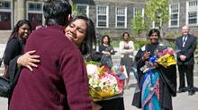 Commerce grad Jasrene Padman hugs a friend after convocation Tuesday at Dalhousie University. She is heading back to her homeland of Malaysia. (Devaan Ingraham for The Globe and Mail)