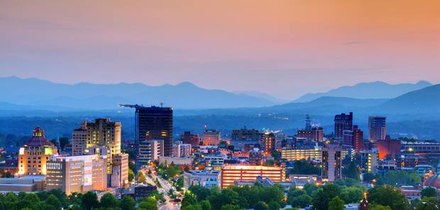 Asheville, North Carolina's skyline is nestled in the Blue Ridge Mountains.