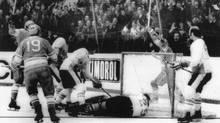 Canada players and members of the Russian National Hockey Club during Game 8 of the Canada-Russia Summit Series played in Moscow, Sept. 28, 1972. Russian player Alexander Yakushev scores the first goal against Team Canada goalie Ken Dryden during Thursday evening's match. Players from left, Alexander Yakushev (arm raised) and Vladimir Shadrin (19). Canada won the match and series with a score of 6-5. (TASS)
