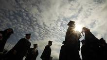 Graduating students arrive for Commencement Exercises at Boston College in Boston, May 20, 2013. (Brian Snyder/Reuters)