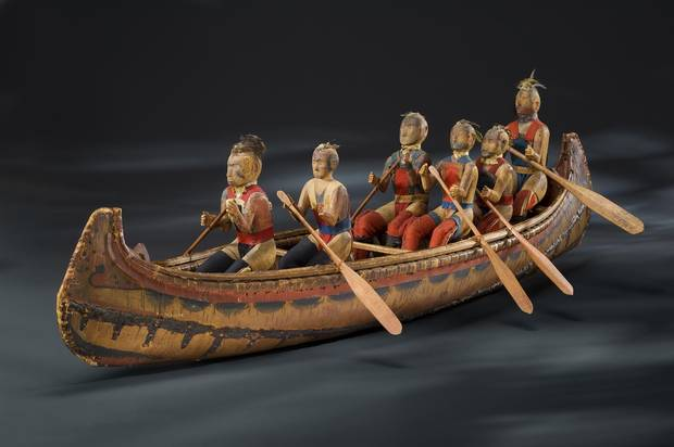 A model canoe with figures representing individual Indigenous warriors and leaders, made by the Odawa chief, Assiginak, in about 1825.