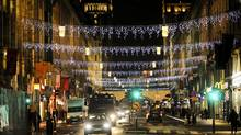 Cars drive on an illuminated street of central Stockholm on November 20, 2011 as the end-of-year holiday season was officially opened. (JESSICA GOW/JESSICA GOW/AFP/GETTY IMAGES)