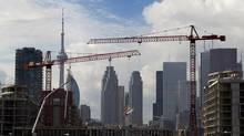 Cranes dominate Toronto's skyline as construction work continues on condominiums in the Canary District east of the downtown. (Peter Power/The Globe and Mail)