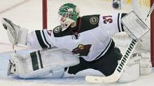 Minnesota Wild goalie Josh Harding makes a save during second period NHL action in Ottawa on Wednesday, November 20, 2013. Harding made 34 saves on 37 shots as the Wild defeated the Senators 4-3. (The Canadian Press)