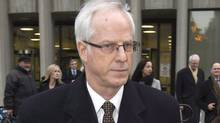 "Former Nortel Networks chief executive Frank Dunn leaves court in Toronto on Monday January 16, 2012. Court is hearing that three former Nortel executives accused of defrauding millions from the now insolvent tech firm did so by knowingly participating in a ""cookie-jar accounting"" scheme (Frank Gunn/The Canadian Press)"