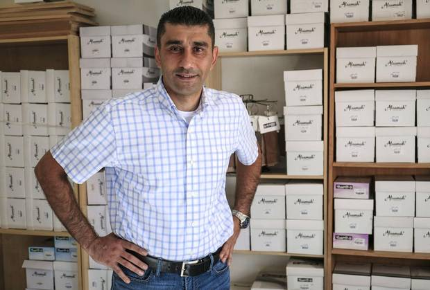 Syrian refugee Rami Tawil is trying to re-start his Syrian business selling socks and hosiery in Calgary.