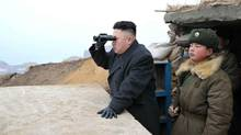 In this March 7, 2013 photo released by the Korean Central News Agency (KCNA) and distributed March 8, 2013 by the Korea News Service, North Korean leader Kim Jong Un, center, uses binoculars to look at the South's territory from an observation post at the military unit on Jangjae islet, located in the southernmost part of the southwestern sector of North Korea's border with South Korea. Seven years of UN sanctions against North Korea have done nothing to derail Pyongyang's drive for a nuclear weapon capable of hitting the United States. They may have even bolstered the Kim family by giving their propaganda maestros ammunition to whip up anti-U.S. sentiment and direct attention away from government failures. (KCNA via KNS/AP)