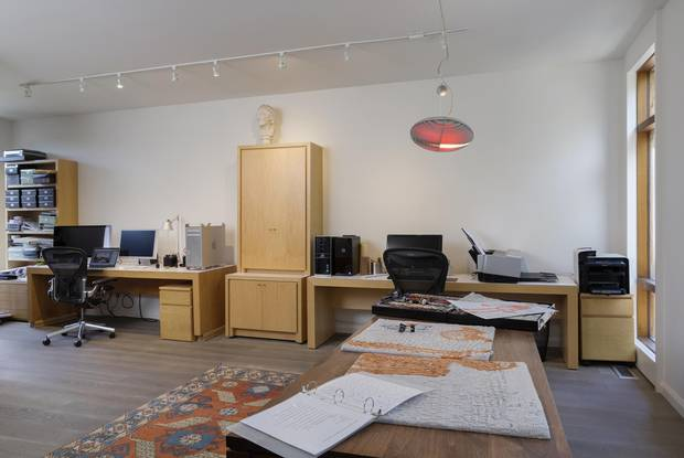The office features multiple workspaces.