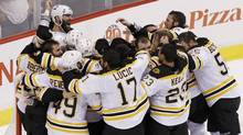 The Boston Bruins celebrate after defeating the Vancouver Canucks in Game 7. (ANDY CLARK/Andy Clark/Reuters)