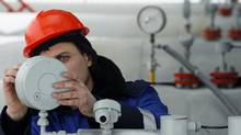 A Gazprom technician works on a pressure gauge at the gas export monopoly's Sudzha compressor station, January 14, 2009. (Denis Sinyakov/Reuters/Denis Sinyakov/Reuters)