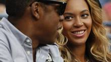 Beyonce Knowles, right, and Jay-Z during at the U.S. Open tennis tournament in New York, Monday, Sept. 12, 2011. (Charles Krupa/Associated Press)