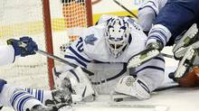 Toronto Maple Leafs' Ben Scrivens (30) dives on a loose puck in front of the goal in the second period of an NHL game against the Philadelphia Flyers on Monday, Feb 25, 2013, in Philadelphia. (Michael Perez/AP)