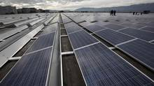 Solar panels on the roof of a building in Geneva, Switzerland. (DENIS BALIBOUSE/REUTERS)