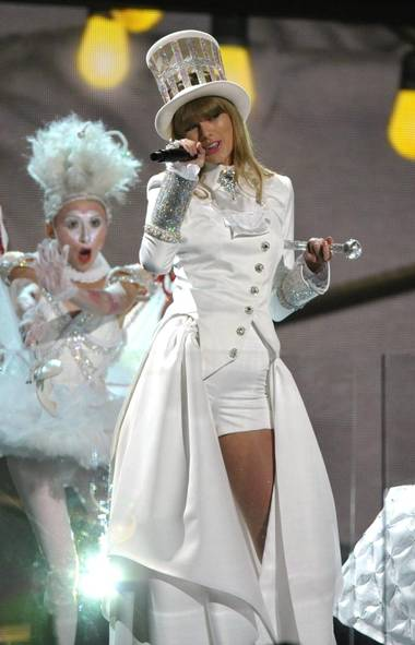 "Taylor Swift was the night's first performer, singing her hit ""We Are Never Ever Getting Back Together."" (John Shearer/AP)"