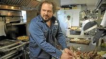 Montreal chef Martin Picard prepares pigs heads. (Kevin Van Paassen/The Globe and Mail)