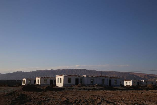 China's efforts to win favour in Xinjiang include new social and education benefits, as well as subsidized housing, like this development in Shanshan county.