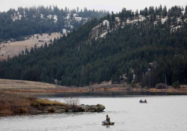 Boaters fish for trout on Jacko Lake, near the site of a proposed expansion of Kinder Morgan's Trans Mountain pipeline.