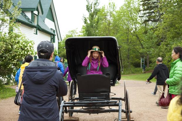 Cavendish, PEI: One of the travellers dons the signature Anne of Green Gables hat and red pigtails at Green Gables Heritage Place.