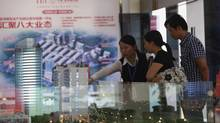 People visit the International Bag City's investment promotion center in Pinghu, Zhejiang province, on Sept. 28, 2012. The $236-million trading centre is the sort of initiative China's leaders want to see sprouting across the economy. (ALY SONG/REUTERS)