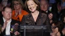 Alberta Premier Alison Redford is pictured at the Progressive Conservatives' part convention on Nov. 22, 2013. Ms. Redford is shaking up her cabinet, with 10 ministers taking on new portfolios. (Jeff McIntosh/The Canadian Press)