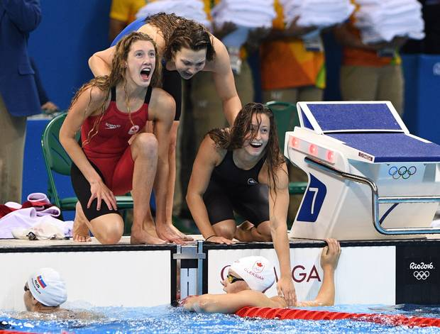 Canada's Taylor Ruck, left to right, Brittany MacLean, Katerine Savard and Penny Oleksiak take bronze in the women's 4 x 200m freestyle relay during the 2016 Olympic Summer Games in Rio de Janeiro, Brazil in Wednesday, Aug. 10, 2016.