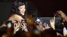 "Singer Rihanna performs at The Forum in Kentish Town in London November 19, 2012. Rihanna is touring to promote her latest album ""Unapologetic."" (Dylan Martinez/Reuters)"