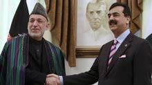 Afghan President Hamid Karzai, left, shakes hands with Pakistan's Prime Minister Yousaf Raza Gilani at Prime Minister House in Islamabad, Pakistan on Thursday, Feb. 16, 2012. (B.K. Bangash/AP/B.K. Bangash/AP)