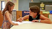 Millie Bolton works on language skills with Westminster Public School principal Lillian Lahe. Millie will be attending the full-day senior kindergarten program this year. (Anne-Marie Jackson/ The Globe and Mail/Anne-Marie Jackson/ The Globe and Mail)