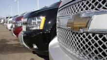 The company logo shines off the chrome grille of a Suburban on the lot of a Chevrolet agency in the south Denver suburb of Lone Tree, Colo (David Zalubowski/AP)