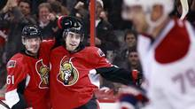 Ottawa Senators' Andre Benoit, left, celebrates teammate Mika Zibanejad's goal as Montreal Canadiens' Andrei Markov skates by during the second period of their NHL hockey game in Ottawa January 30, 2013. (BLAIR GABLE/REUTERS)