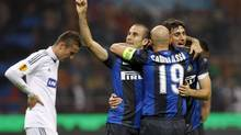 Inter Milan's Rodrigo Palacio celebrates with his teammates Esteban Cambiasso (C) and Diego Milito after scoring against Partizan Belgrade during their Europa League Group H soccer match at San Siro stadium in Milan October 25, 2012. (ALESSANDRO GAROFALO/REUTERS)
