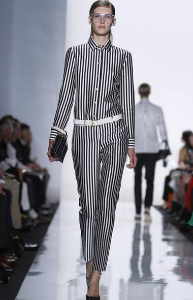 Kors is a guy who always sees the glass half full. Witness his uplifting spring collection, arguably the designer's most statement-making in seasons. Inspired by sunny California, particularly life in Palm Springs where mid-century modern architecture prevails, the mood was very op-art-optimistic . Think rounded pockets on coats and minis, stripes and lots of them, shifty mod shapes. Almost all of the fabrics were bonded and double-faced (even the leather) giving the whole collection a crisp, polished feel. I loved seeing the Kors fantasy through his eyes. And I could, literally: The pool and sky prints were taken by the designer on a trip to Palm Springs. (CARLO ALLEGRI/REUTERS)