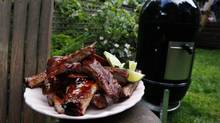 Pecan smoked pork ribs with sauce and limes. (Deborah Baic/The Globe and Mail)