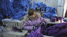 An employee works at a garment factory in Wuhu, Anhui province January 2, 2012. (JIANAN YU/REUTERS)