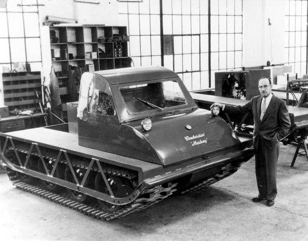 Joseph-Armand Bombardier, designer of the Bombardier snowmobile, stands beside the latest model of the machine on the production line of his Valcourt, Que. factory in this 1960 photo.